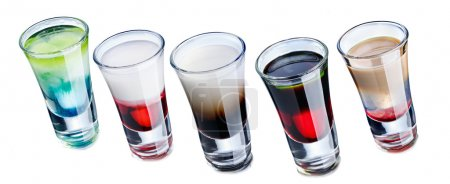 Shot glasses with fancy cocktails
