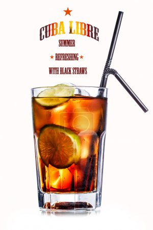 Photo for Cube libre. Cocktail with soda with rum and lime slices in faceted highball glass - Royalty Free Image