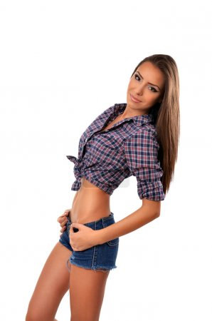 Attractive young brunette woman posing with hand on hip