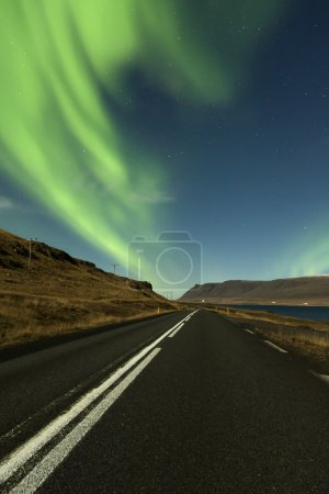 An display of Aurora Borealis on road near Hvalfj�...