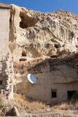 Cave house with satellite dish