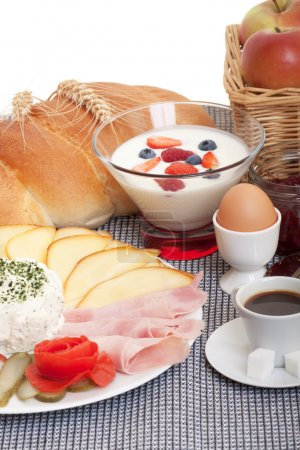Photo for Continental breakfast with fruit, cheese, sausage and bread - Royalty Free Image