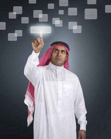 Arabian businessman pressing touchscreen button