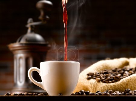 Photo for Poured into a coffee cup in a café setting from ancient - Royalty Free Image