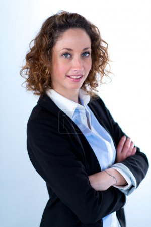 Portrait of a young executive woman on light backgroung