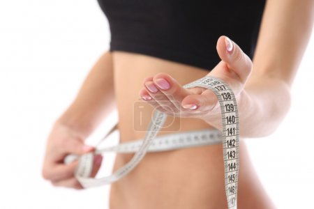 Measure tape around slim beautiful waist.
