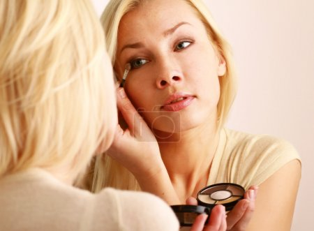 Woman caring of her  skin on the face