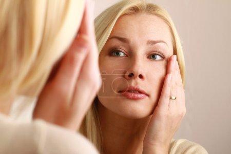 Woman caring of her beautiful skin