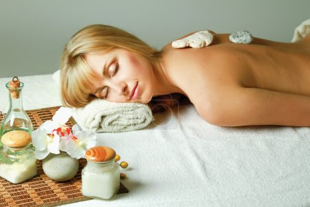 Woman relaxing during a spa stone therapy