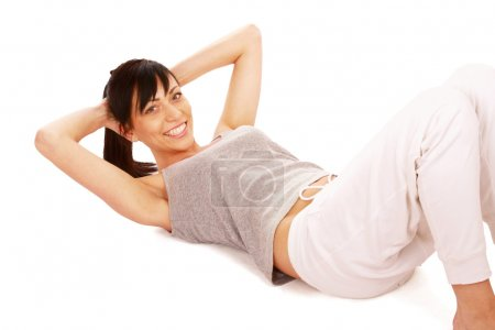 Photo for Woman doing strength exercises for abdominal muscles, isolated on white background - Royalty Free Image