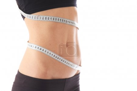 Slim waist with a tape measure around it