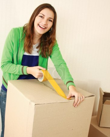 Moving house, woman with boxes