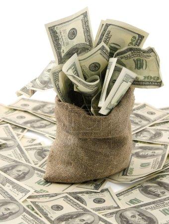 Photo pour Toile sac d'argent avec des billets de cent dollars - image libre de droit