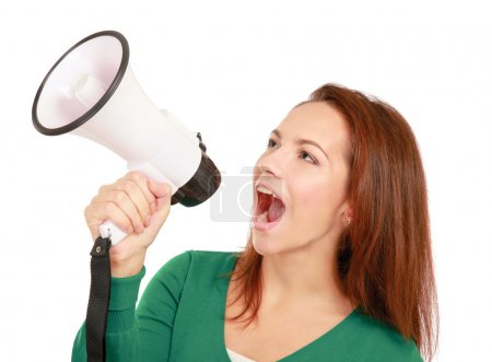 Photo for Portrait of young girl shouting with megaphone over white background - Royalty Free Image