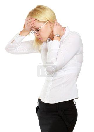 Businesswoman with a headache holding head