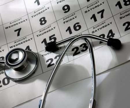 Stethoscope Over calendar.