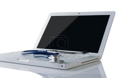 Stethoscope on the keyboard.