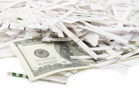 Heap of paper strips and dollars