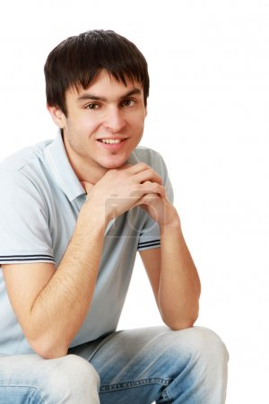 Photo for A college boy sitting isolated on white background - Royalty Free Image