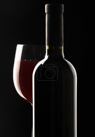 bottle with red wine and glass.