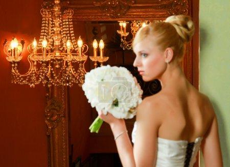 Bride blonde in wedding dress