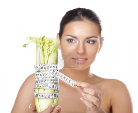 Woman with vegetable with a measure tape