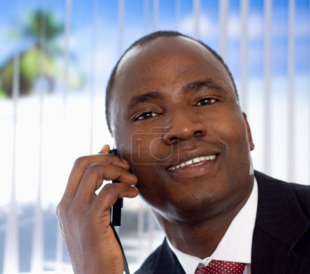 Photo for Afro-American businessman with phone - Royalty Free Image