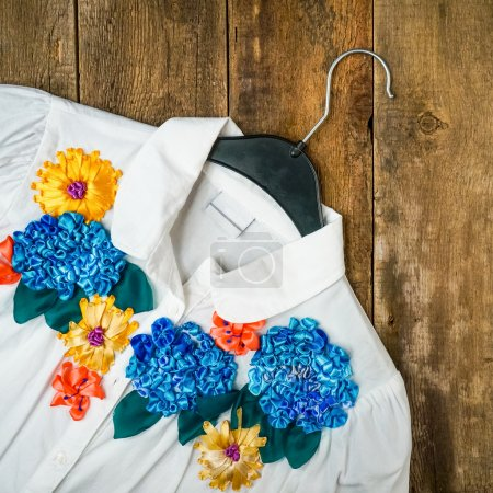 Silk flower embroidery on white blouse