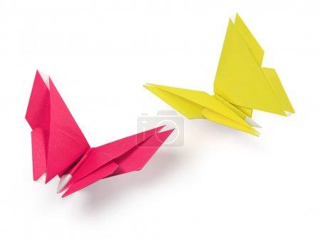 Foto de Mariposas de origami de papel sobre el fondo blanco - Imagen libre de derechos
