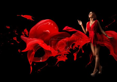 Photo for Beautiful phantasy woman covered in red on a dark background. Spray paint in the form of a broken heart of love. Lady in red. - Royalty Free Image