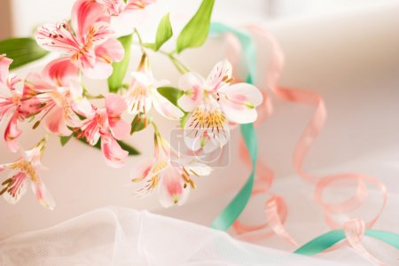 Summer wedding celebration. Wedding flowers and wedding rings newlyweds. Beautifully decorated with flowers.