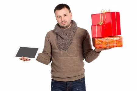 Young man holding purchased gifts