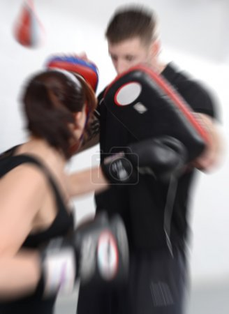 Photo for Working out with mitts or gloves and pads - Royalty Free Image