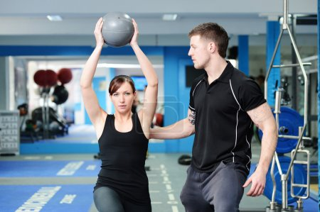 Using medicine ball with personal trainer
