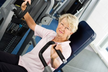 Photo for Older woman working out at the gym - Royalty Free Image