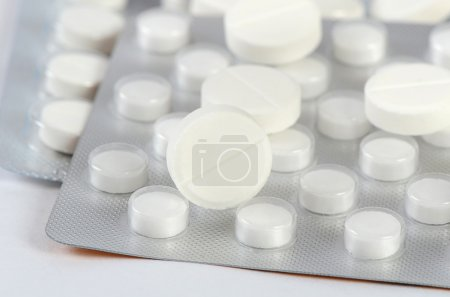 Tablets in packing. A medical background