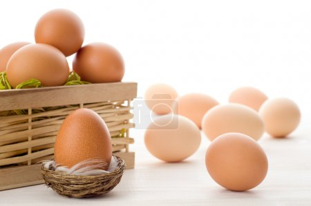 Raw eggs on a white table