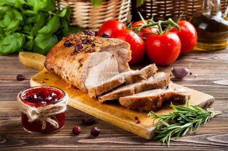 Photo for Roasted pork loin with cranberry and rosemary - Royalty Free Image