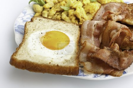 Photo for Eggie bread, scrambled eggs and fried bacon - Royalty Free Image