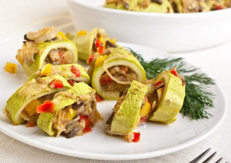 Roasted marrow squash stuffed with vegetables, meat and mushrooms