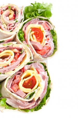 Photo for Wrapped tortilla sandwich rolls cut in half - Royalty Free Image