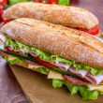 Long Baguette Sandwich with lettuce, slices of fre...