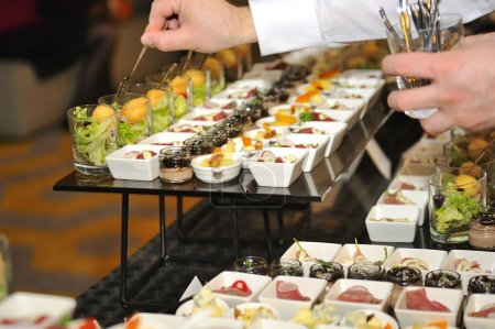 Catering stuff arranging finger food