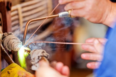 Repairing old transformer and welding copper wire...