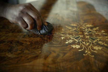 African Carpenter Polishing Antiques