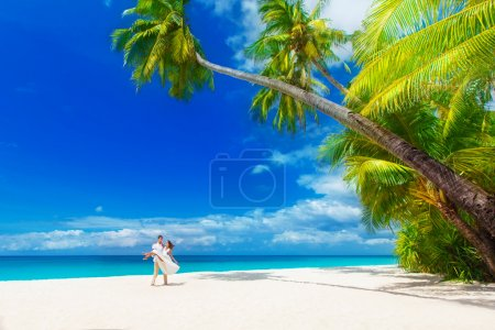 Dream scene. young loving happy couple on tropical beach with pa