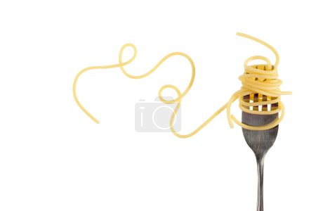 Photo for Swirls of cooked spaghetti with fork - Royalty Free Image