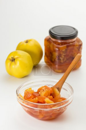 Photo for Sweet quince chutney in glass dish with spoon - Royalty Free Image