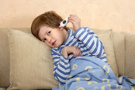 The boy with electronic thermometer