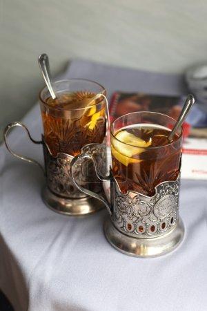 Two glasses of tea with lemon